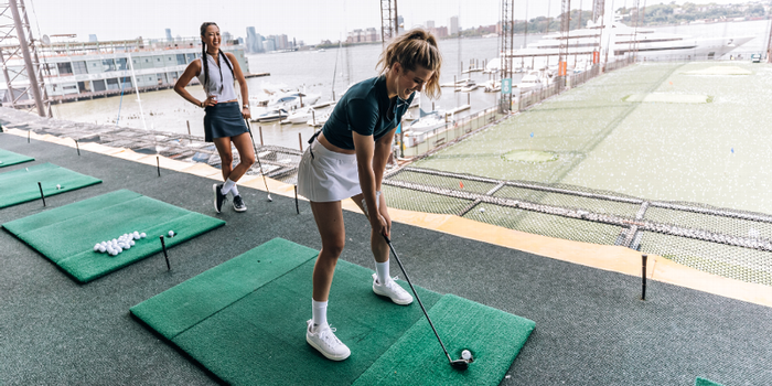 How much can LPGA star Michelle Wie teach tennis pro Eugenie Bouchard in one golf lesson?